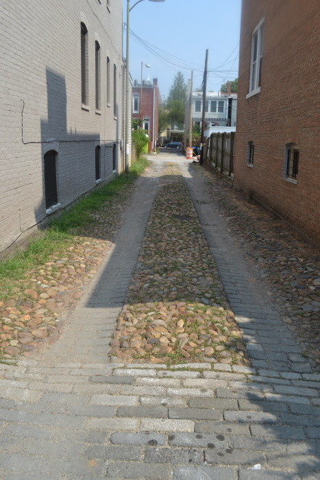 Sadly, their alley was not listed. Which was partly a relief, as their alley had - in one leg - the above river-stone pavement. What would happen to this during a repair was anyone's guess.
