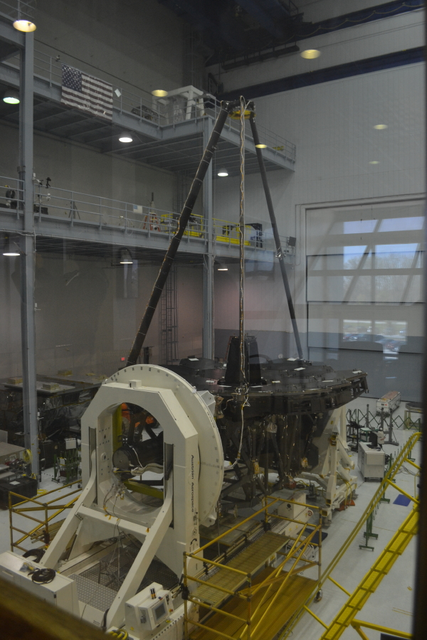 The telescope inside its clean room. The primary mirrors are protected by black covers.