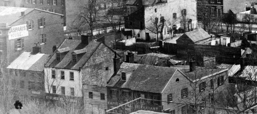 "In this detail of an 1863 picture, taken from the top of the Capitol, Casparis's old and new buildingd can be seen: The old bowling alley is front and center, marked ""Capitol Hill Restaurant"" while the new hotel is all the way to the left. (LOC)"