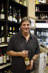 Jon Genderson, Schnedier's of Capitol Hill, holding the Sauvingnon Blanc the writer ended up drinking with dinner.  Photo by Sharee Lawler