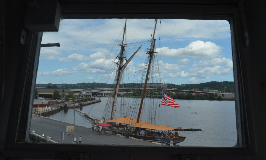 The Pride of Baltimore II seen through a window of the Barry.