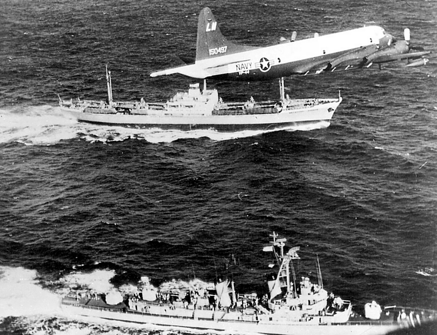 During the Cuban Missile Crisis. Above is a P-3 Orion, in the middle the Soviet ship Mettallurg Ansonov.